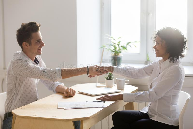 African realtor and caucasian client handshaking making real est stock photos