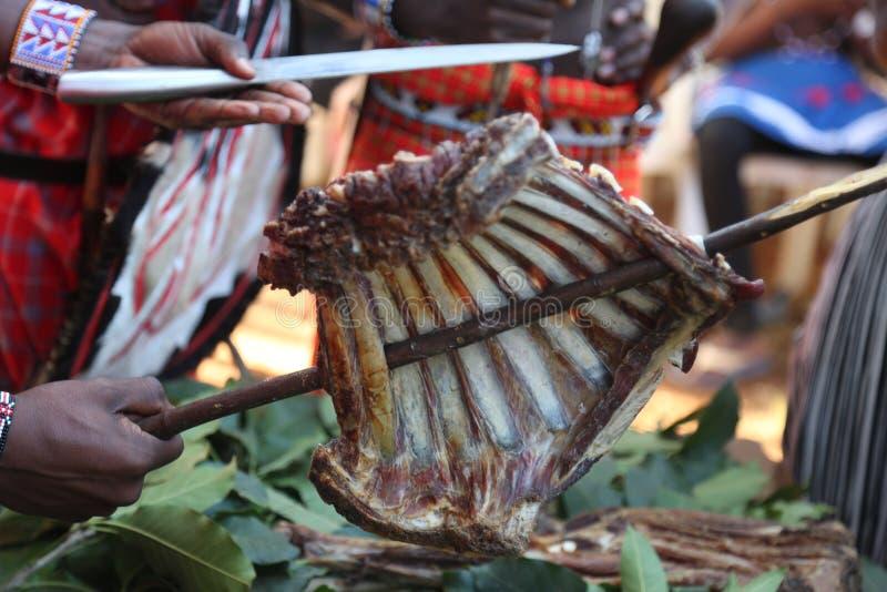 African roast meat `nyama choma` berbcue goat ribs royalty free stock photos