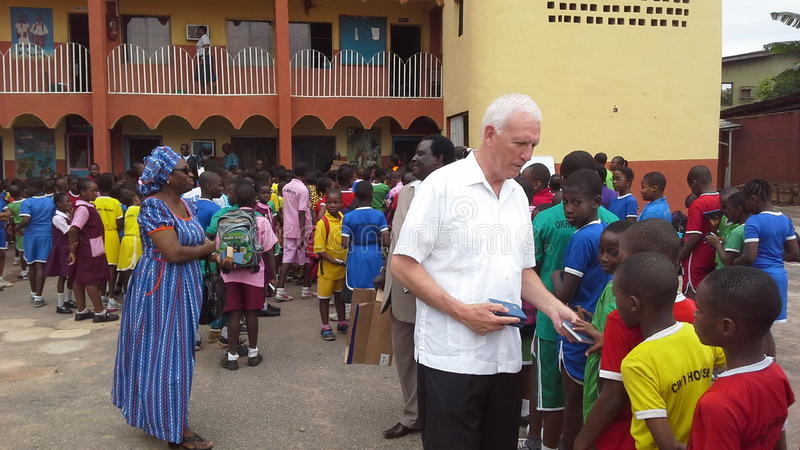 African school children. Michael Steiner of the Gideons International distributes free copies of Testament Bibles at a school in Nigeria, West Africa stock photography