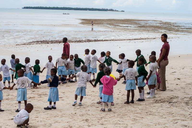 African school kids outdoor with teachers stock photography