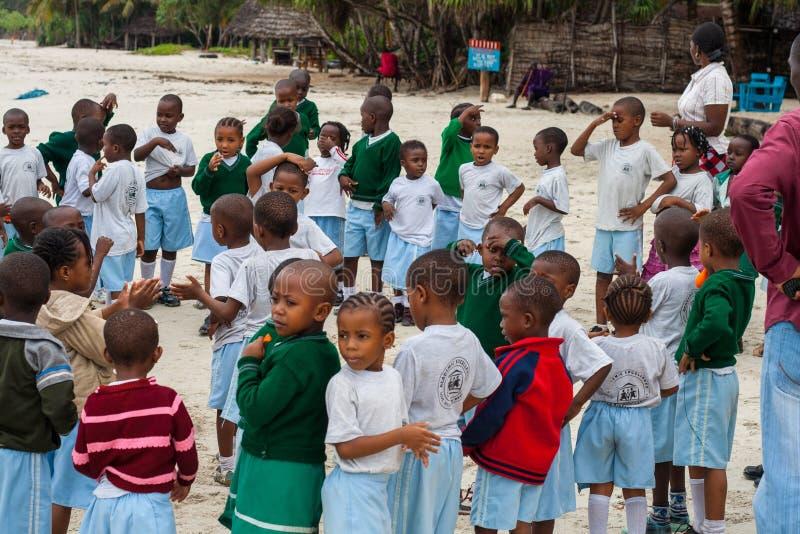 African school kids outdoor with teachers stock image
