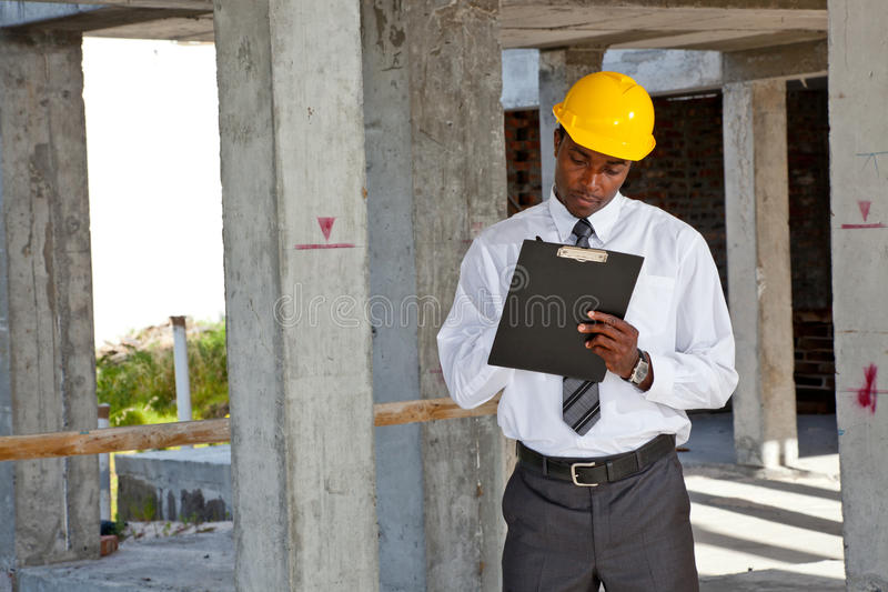 Download African Site Inspector Surveying Construction Site Stock Image - Image of color, horizontal: 38896757