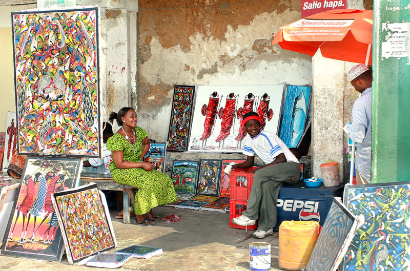 African souvenirs, Art shop outdoors, bright paintings sell, dar stock photos