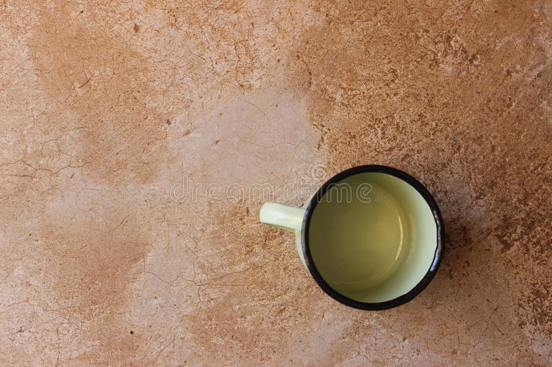 African steel cup on a cement floor stock images