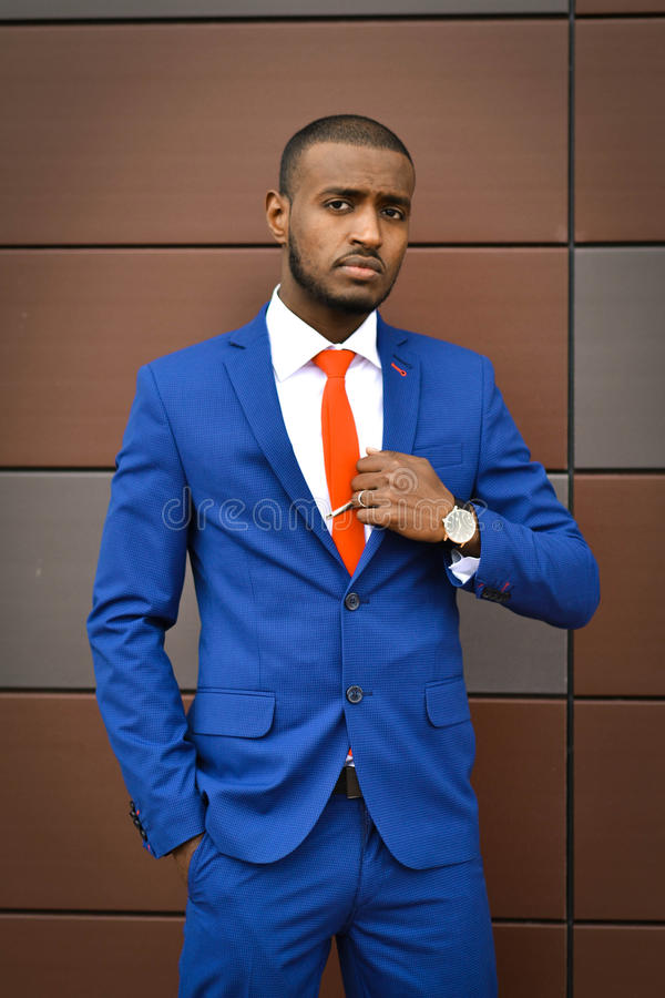African student corrects a tie.Important serious businessman,boss,banker, an office employee, lawyer. royalty free stock images