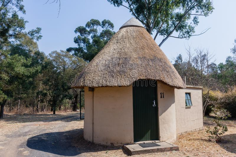 Thatch Round Camping Bungalow. African style thatch grass roofs round bungalow building holiday camps in rural mountains royalty free stock photography