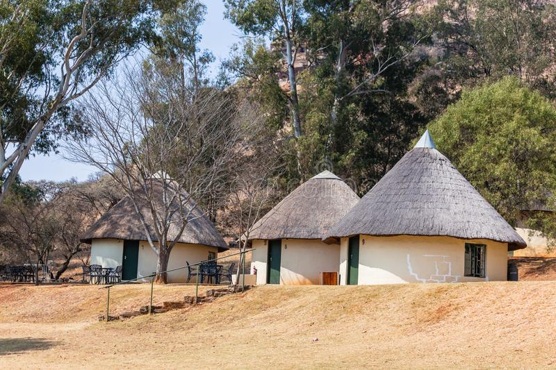 Thatch Round Camping Bungalows. African style thatch grass roofs round bungalows buildings holiday camps in rural mountains royalty free stock images
