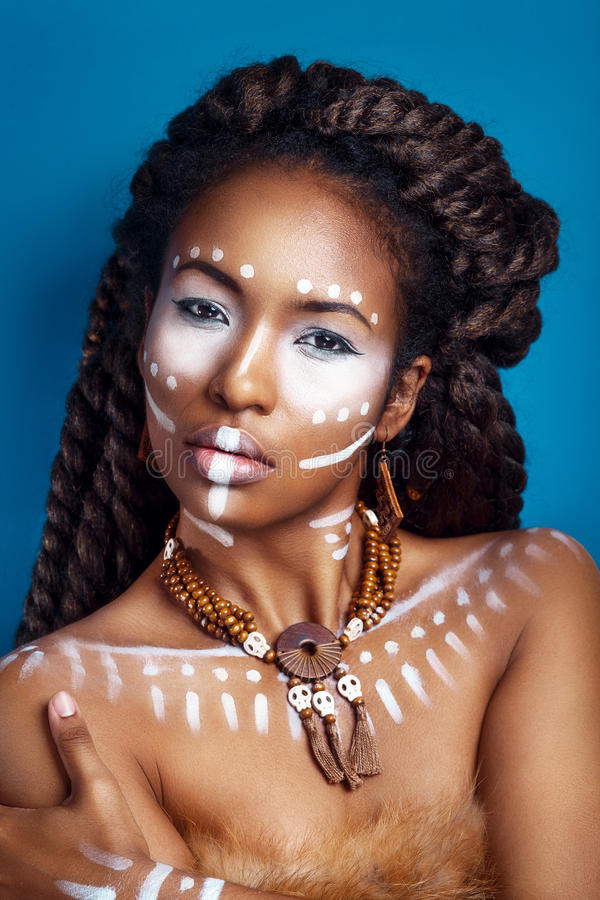 African style woman . Attractive young woman in ethnic jewelry. close up portrait. Portrait of a woman with a painted face. Creative makeup and bright style royalty free stock photo