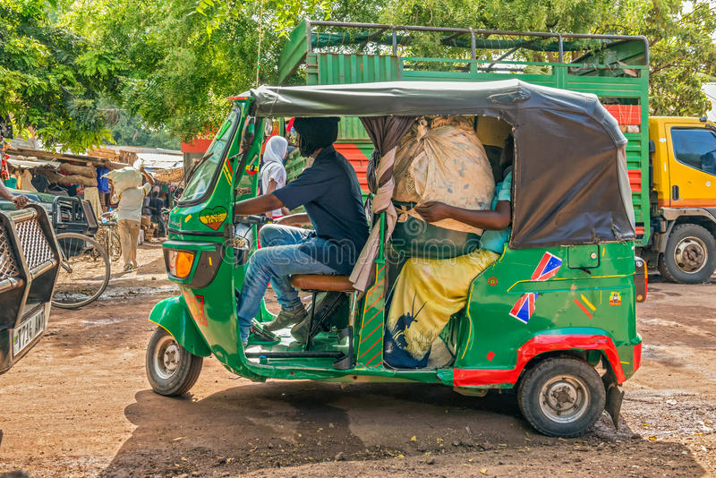 African taxi taking customers from the local marketplace. MTO WA MBU, ARUSHA, TANZANIA - OCTOBER 22, 2014 : African taxi taking customers from the local royalty free stock photos