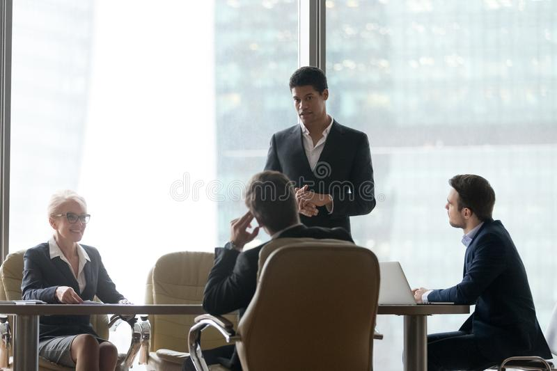 African team leader with businesspeople colleagues at boardroom. During meeting. Multiracial group professional share information talking and reach agreement royalty free stock photography