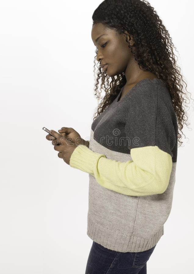 Download African Teen Texting On A Smartphone Stock Photo - Image: 29512114