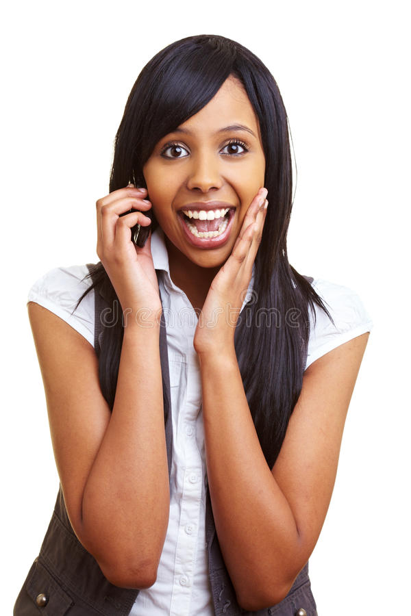 African teenager talking on. Young happy african woman talking into her cell phone royalty free stock images