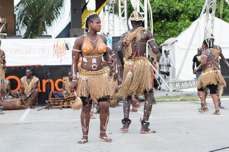 African Traditional Dancers. Abidjan, côte d`ivoire -9 march 2016: presentation of traditional dancers composed of women and men dressed in straws decorated stock image