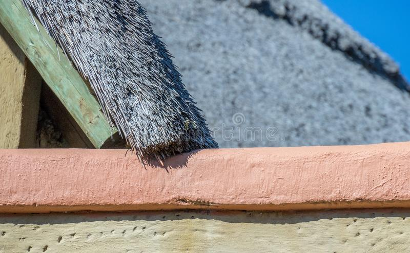 African traditional thatch roofing from below. Close up image at an acute angle of a traditional African thatch roof image with copy space royalty free stock image