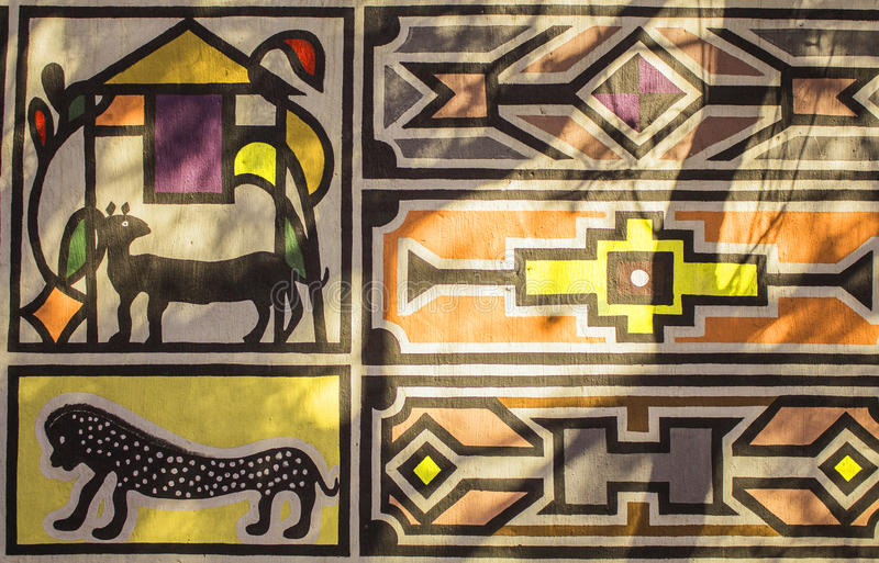 African tribal traditional house ornament, pattern. Traditional house ethnic ornament, pattern of tribe Ndebele in yellow, red, beige tint. Village in South royalty free stock photography