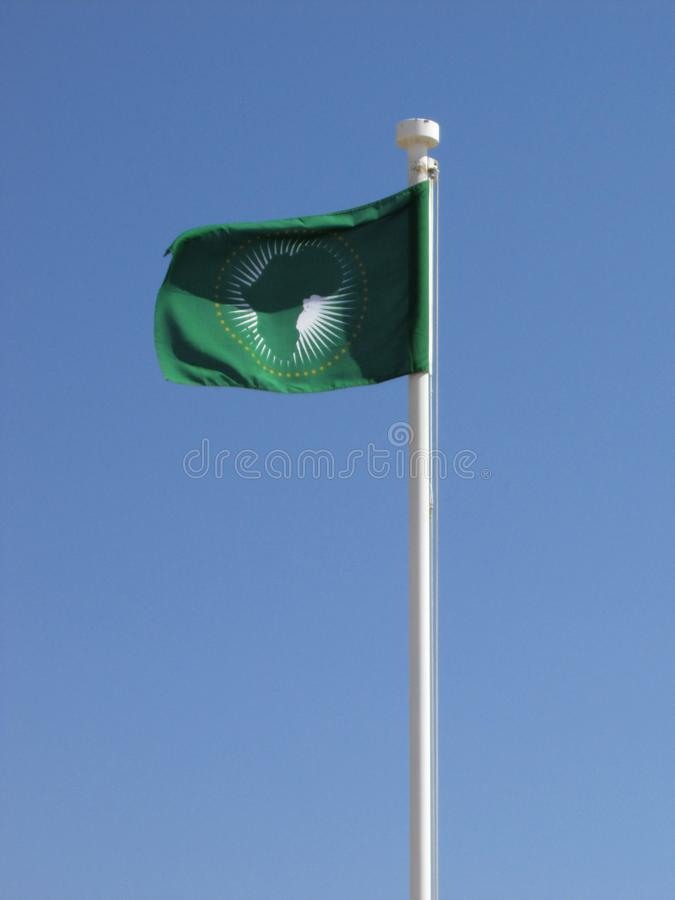 African union flag on flagpole blowing in wind royalty free stock photos