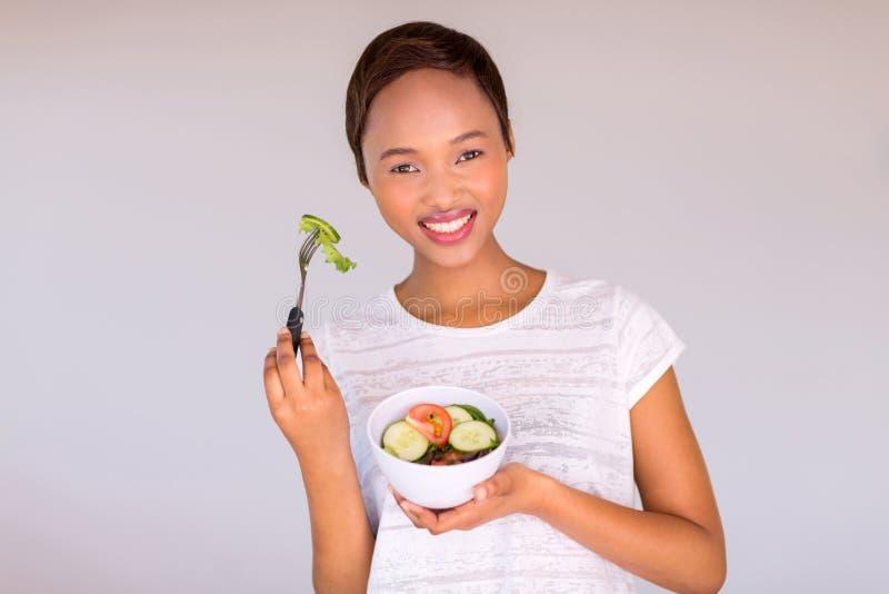 African vegetarian eating salad stock photo