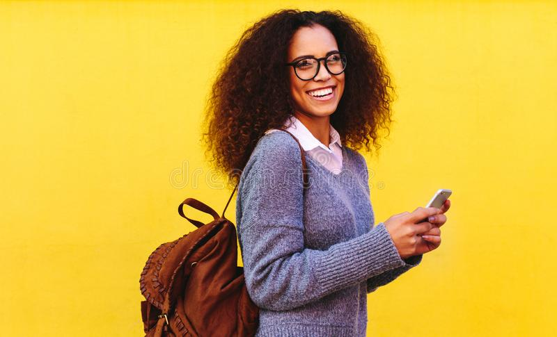 African woman with bag and phone royalty free stock photography