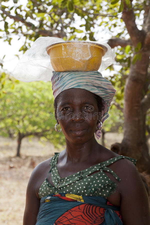 African woman carrying a bowl on her head stock image