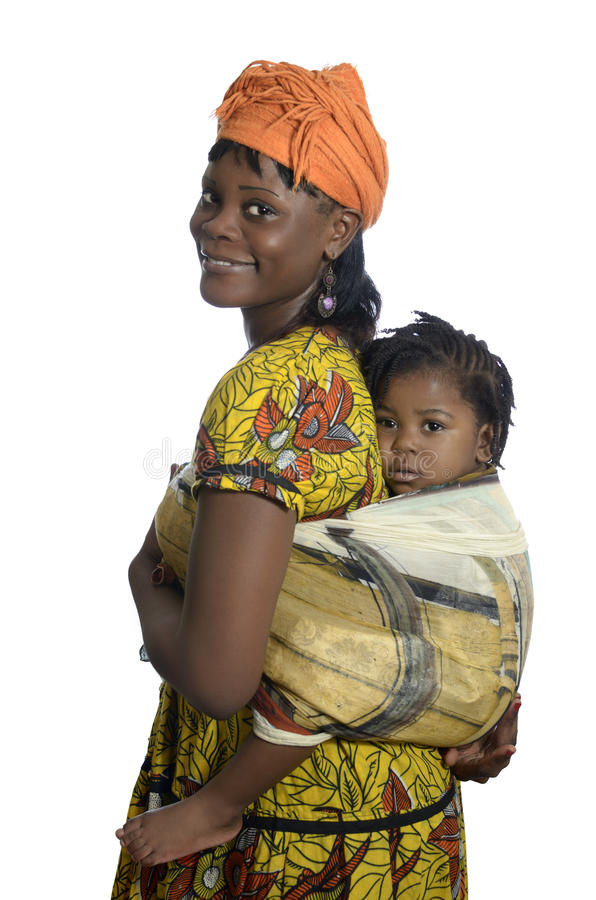 African woman carrying child on back stock image