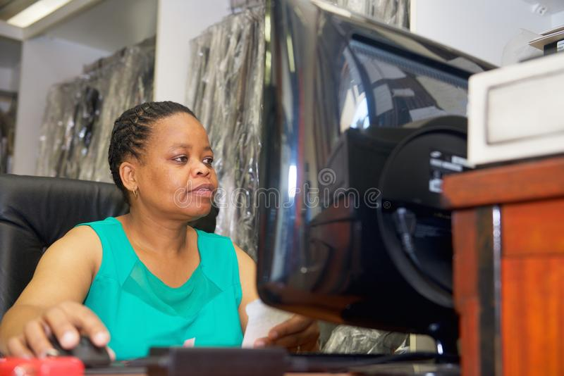 African woman with computer stock photos
