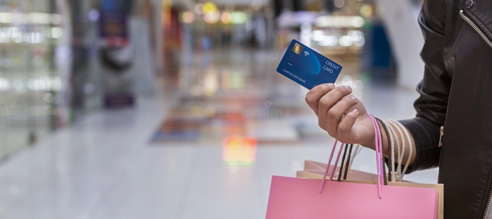 African woman with credit card doing shopping royalty free stock photo