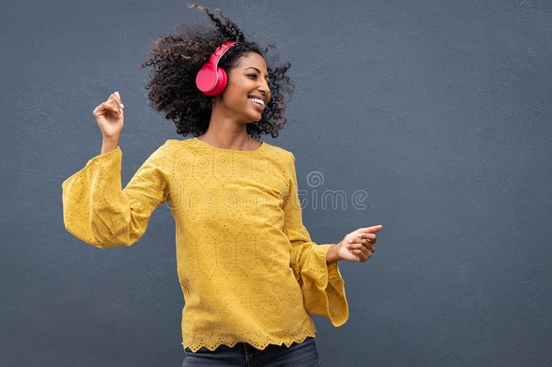African woman dancing and listening music stock photography