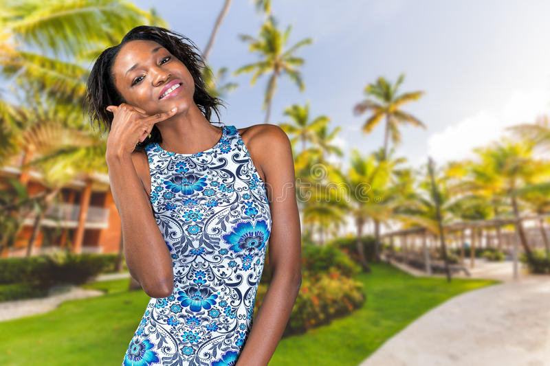 African woman doing call me sign stock photography