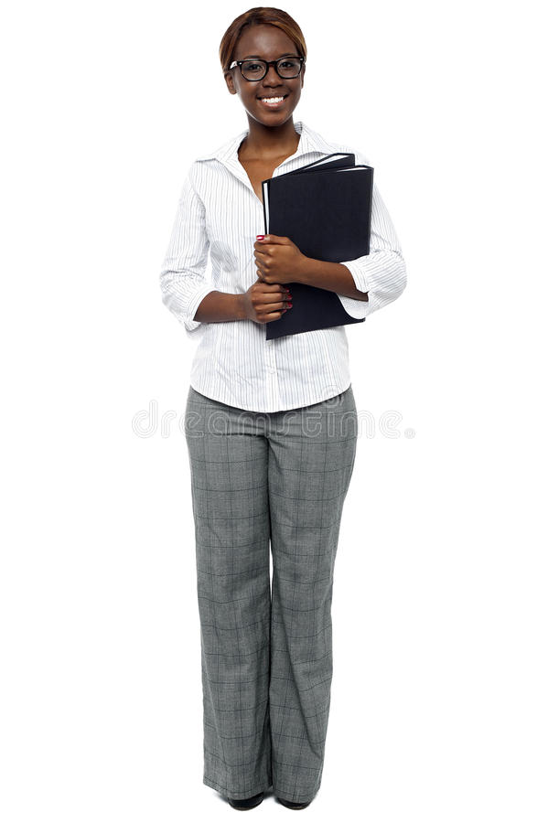 African woman executive ready for presentation. With her binder stock photos