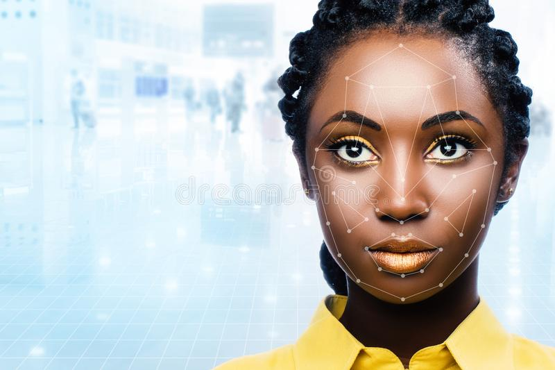African woman with facial recognition scan on face. Close up portrait of attractive african woman with facial recognition technology. Grid with reference areas stock image