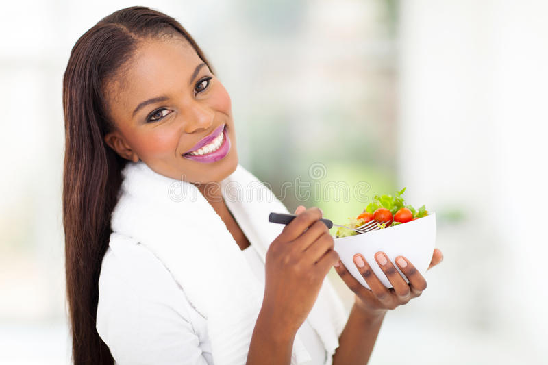 African woman green salad stock photo