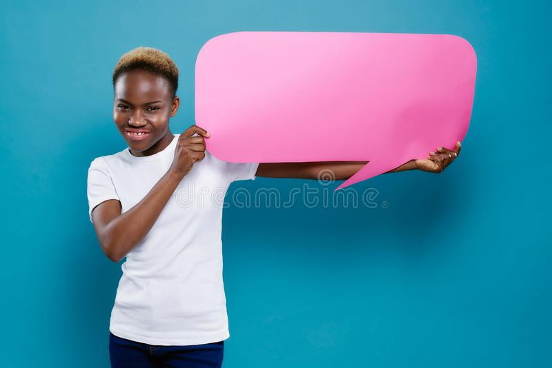 African woman holding cardboard with copy space for text. stock photos
