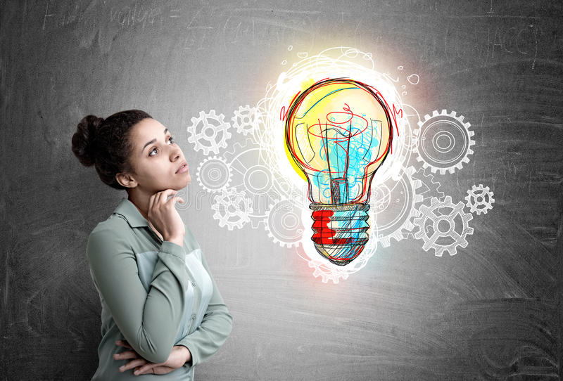 African woman, light bulb and gears stock images