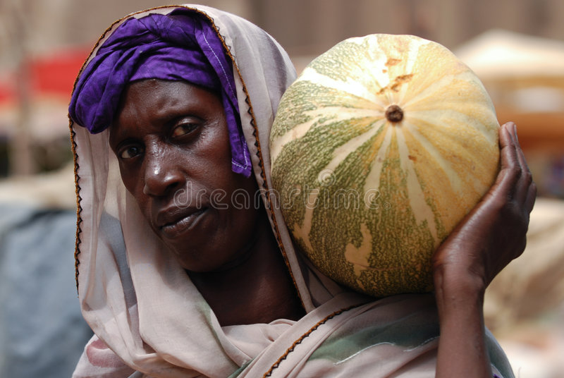 Download African woman with pumpkin editorial stock photo. Image of background - 4410513