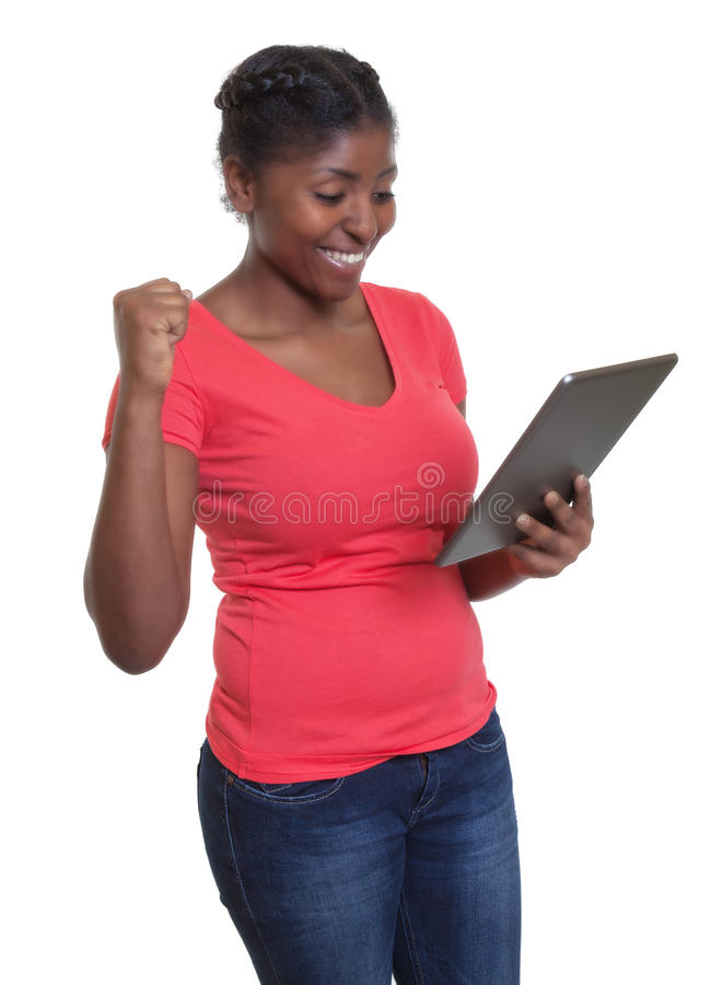 African woman in red shirt winning internet auction royalty free stock image