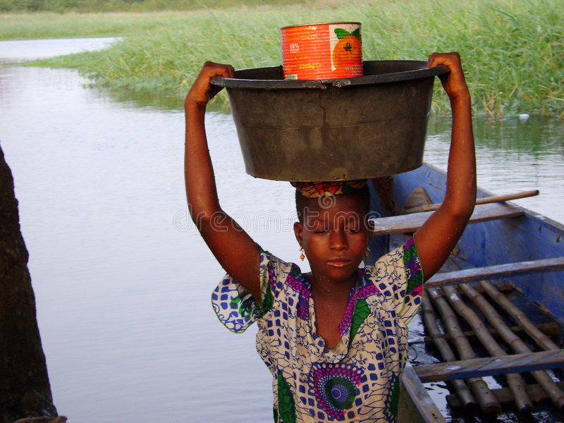 African woman at the river stock photos
