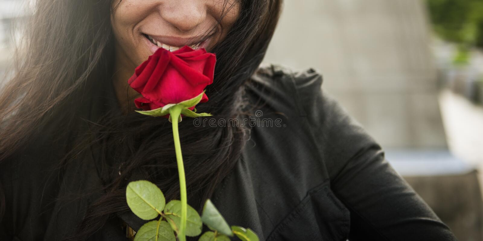 African Woman Rose Flower Love Passion Valentine Concept stock photo