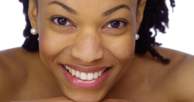 African woman showing off her pearly whites royalty free stock image