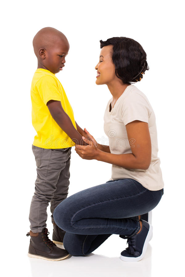 African woman talking son. Beautiful african women talking to her son on white background royalty free stock photo
