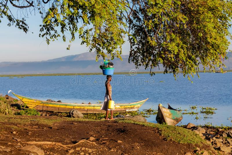 African woman wash clothes on the shore of Lake Victoria. In Africa, Kenya stock photography