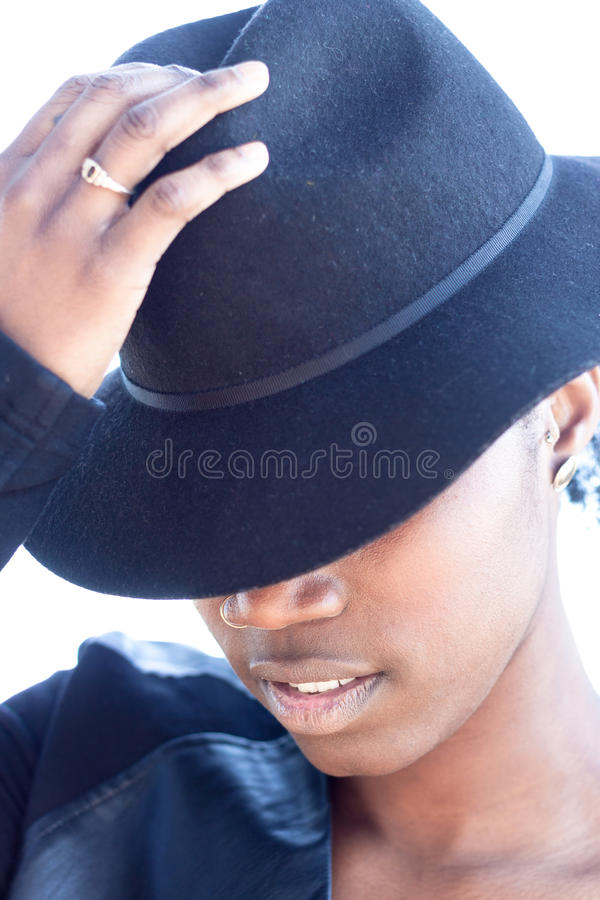 African Woman Wearing Hat with Half-Face Covered royalty free stock images