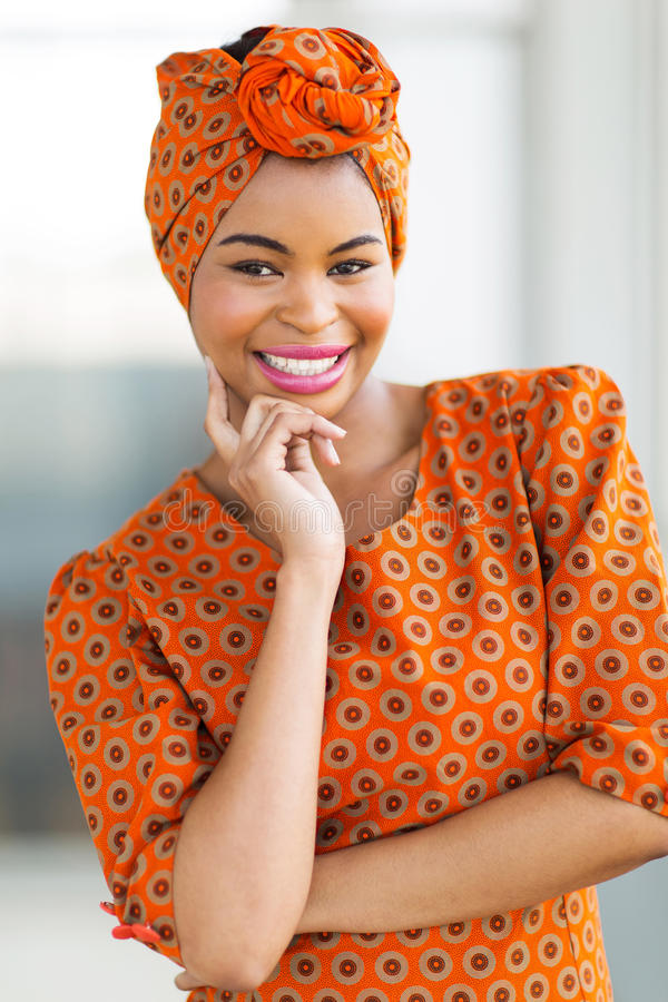 African woman wearing traditional attire. Attractive african woman wearing traditional attire royalty free stock image
