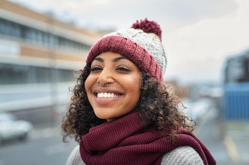 African woman wearing wool cap on winter royalty free stock photo