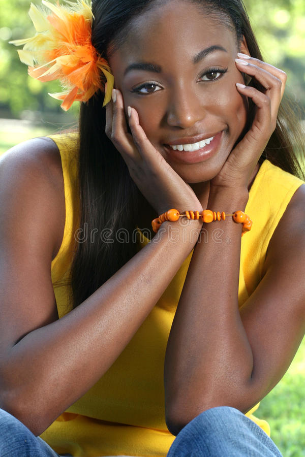 African Woman Yellow: Smiling And Happy Stock Image