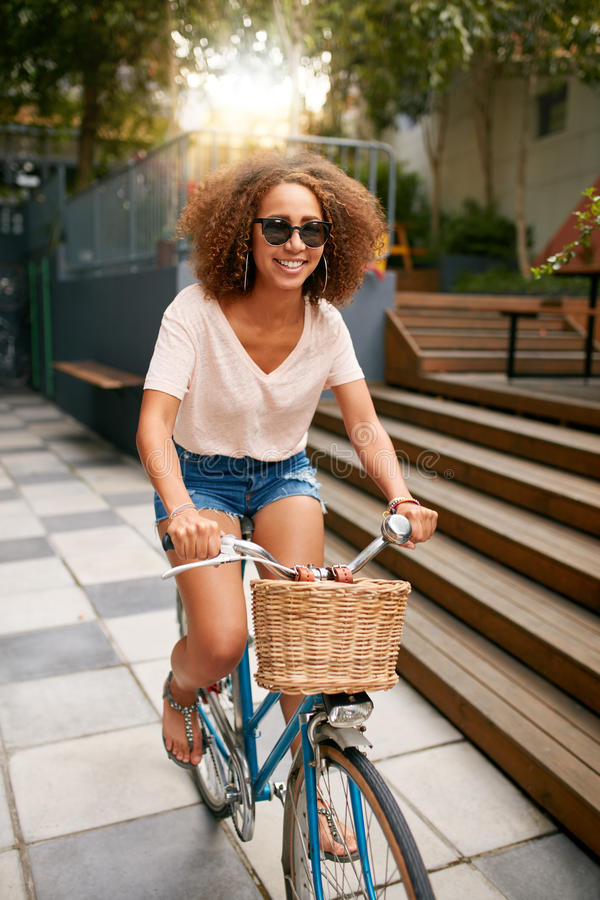 African young girl enjoying bicycle ride royalty free stock photos