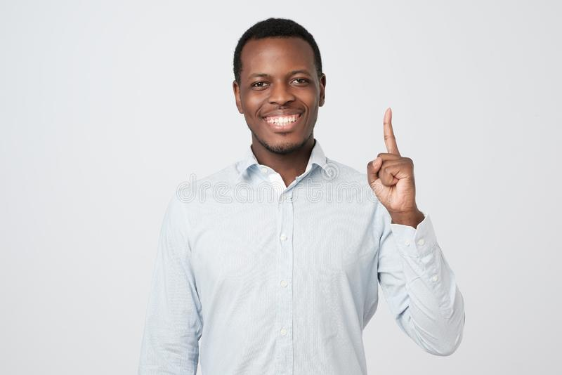 African young man showing index fingers up, giving advice royalty free stock photo