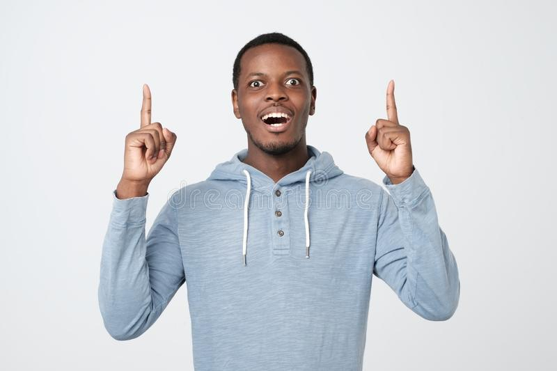 African young man showing index fingers up, giving advice stock image