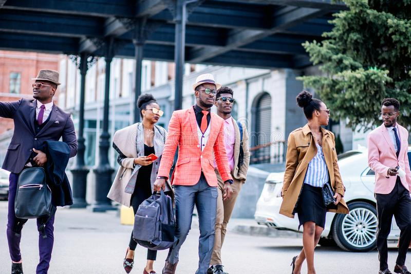 African young people are hurring to the shop as there is a global sales stock photo