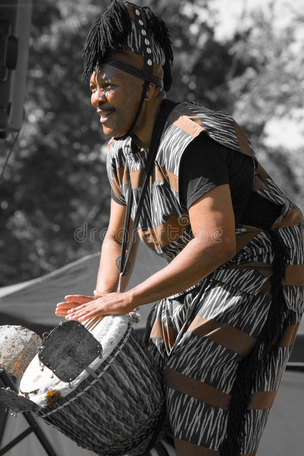 Africian Drummer in traditional clothes royalty free stock photography