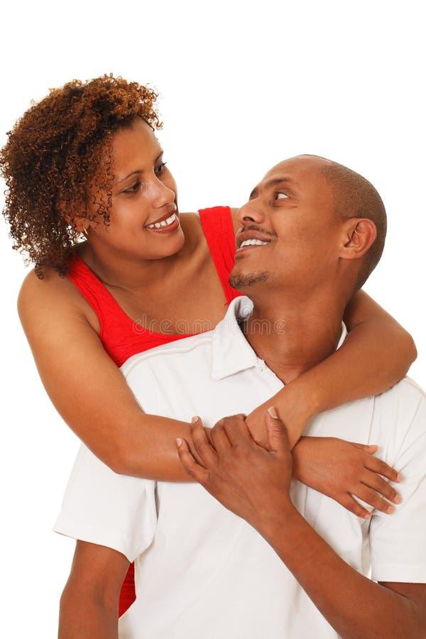Afrikaans Amerikaans die Paar op Wit wordt geïsoleerd stock afbeeldingen